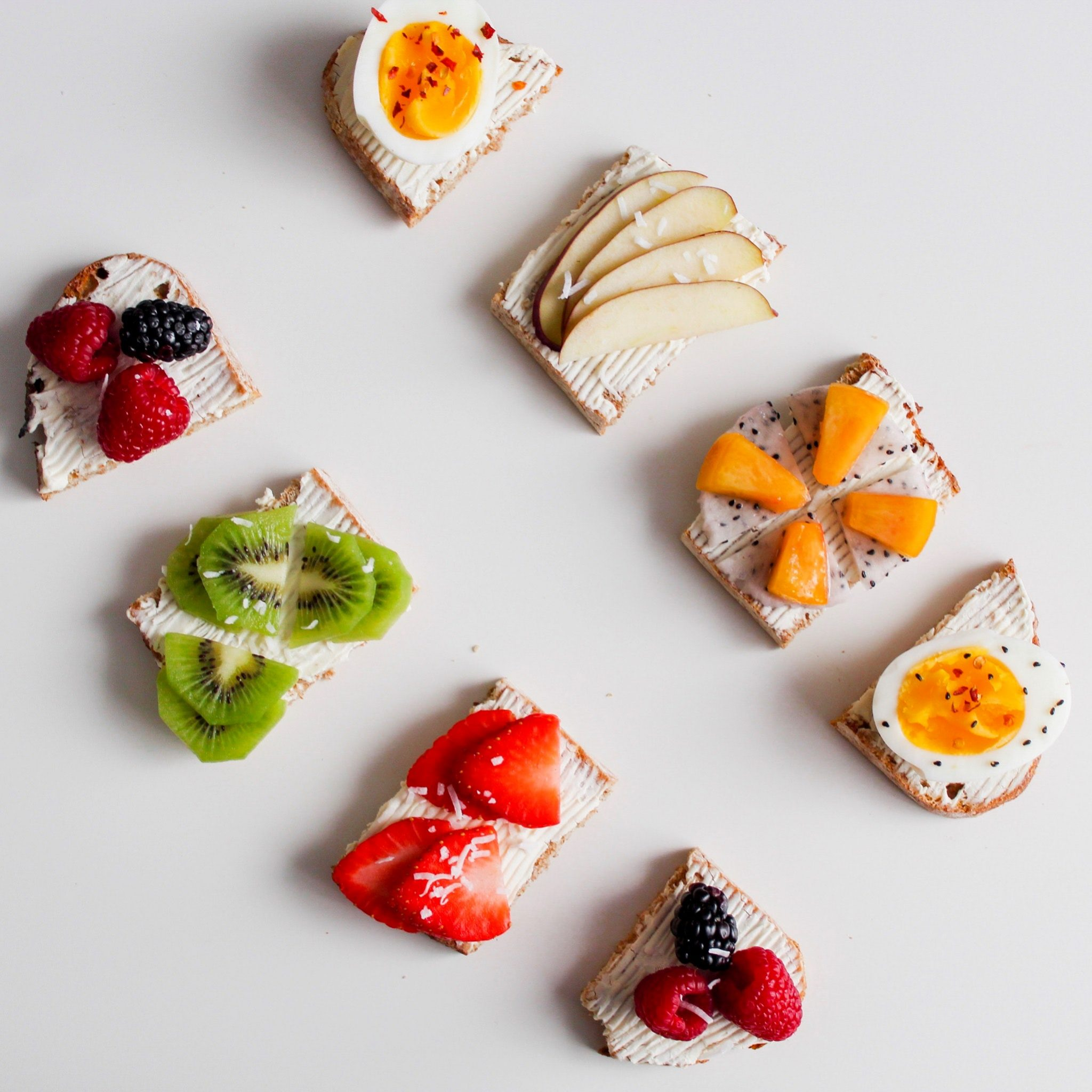 Berries breakfast brunch on melba toast with cream cheese