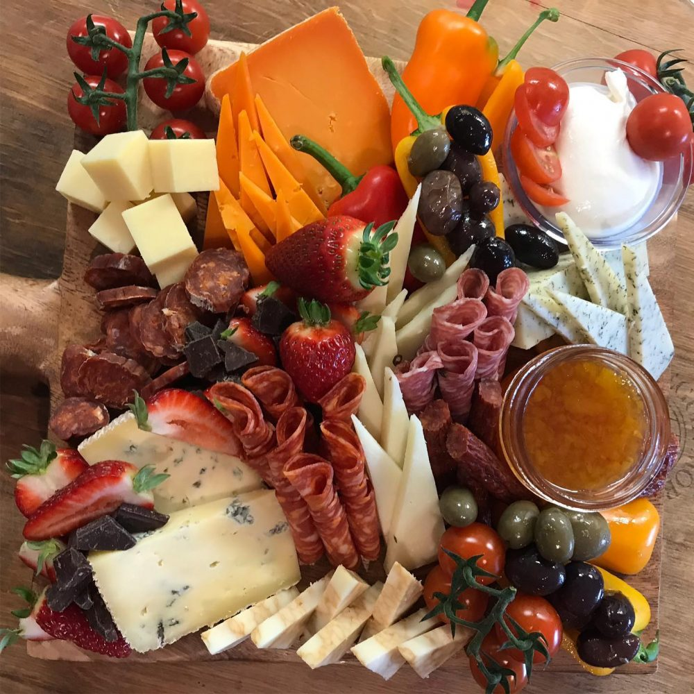 Cutting board of cheese and meats