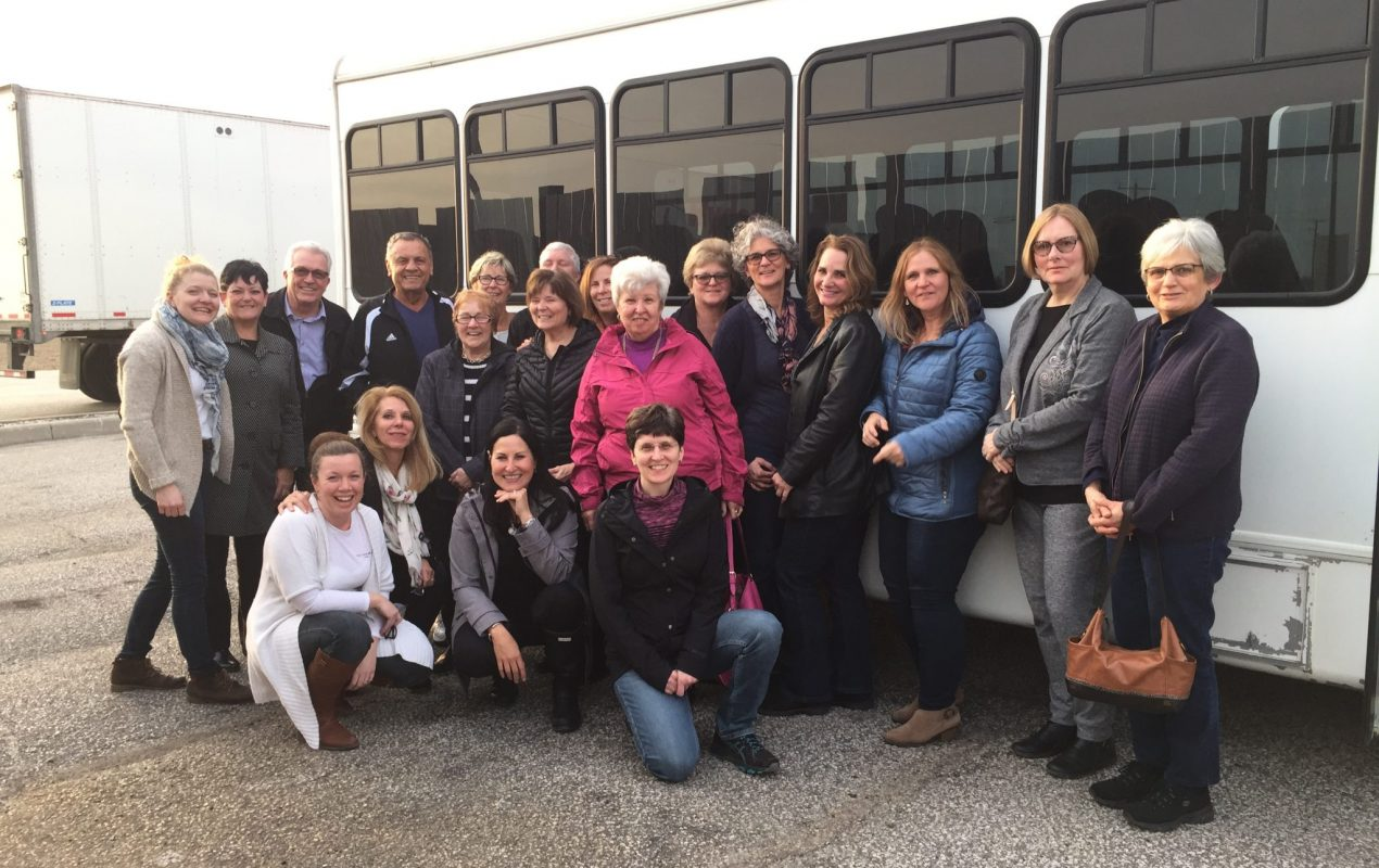 a group photo of the participants outside of the tour bus on the journey to the cheese trail